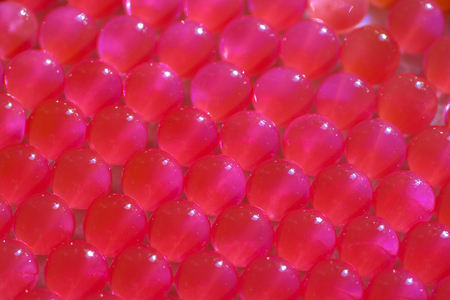 close up of  fuchsia hydrogell balls, full frame