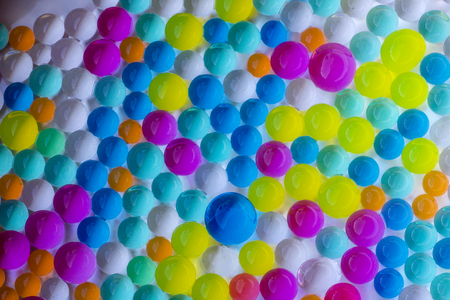group of hydrogel balls in vivid colors  and different sizes on white background Imagens
