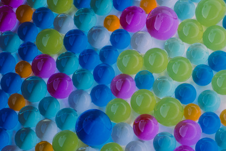large group of  multicolor hydrogel balls on white background Stock Photo