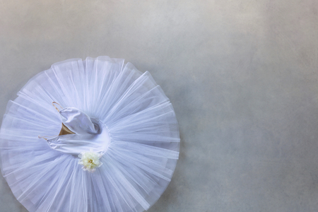 white tutu for classical ballet view from above on grey concrete floor