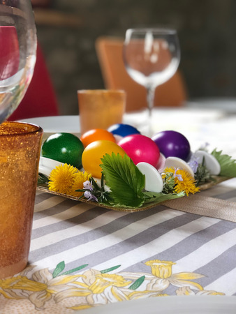 centerpiece for easter with multicolored hard-boiled chicken eggs Фото со стока