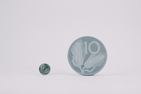 small and large coin of  ten old  italian lira on white background