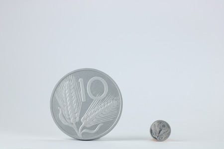 small and large coin of  ten old  italian lira on white background, copy space