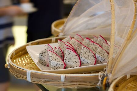 bamboo tray with exotic red  dragon fruit slices