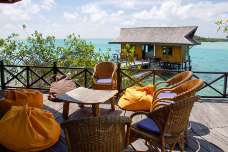 relax area on a wooden balcony in a luxury  tropical resort, derawan islands Stock Photo