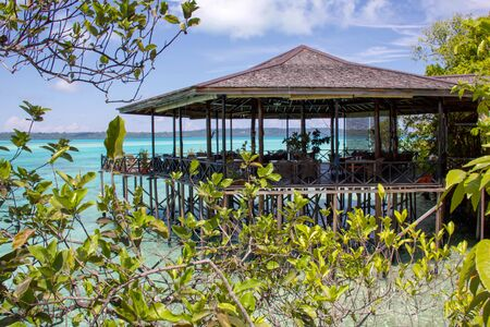 luxury resort restaurant on the water in a tropical island