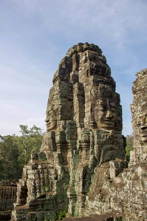 tower  with large buddha faces carved in angkor thom, Cambodia