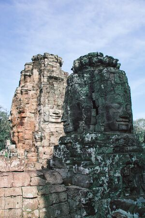 large buddha faces carved on towers of angkor thom temple, Cambodia Stock Photo
