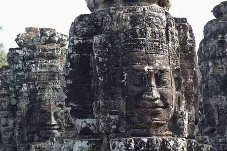large buddha faces carved in stone in angkor thom temple, Cambodia Stock Photo