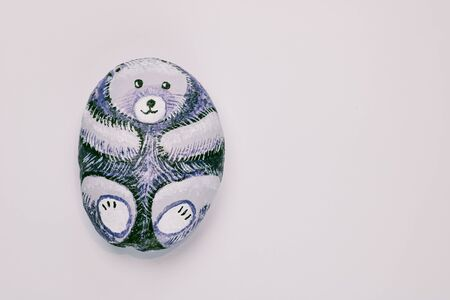 cute painted stone as a bear isolated on white background, copy space