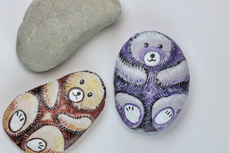 stones homemade painted as cute bears and decorated with acrylic colors