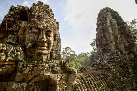 buddha faces on the towers of angkor thom buddhist temple, Cambodia