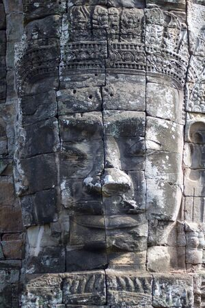 close up of buddha face carved on stone of angkor thom temple, Cambodia