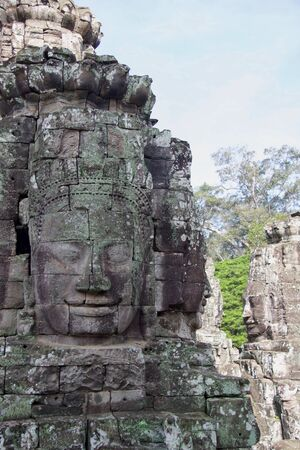 large buddha faces carved on angkor thom temple, Cambodia