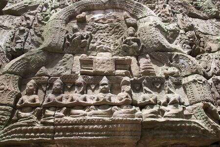 details of decorations carved on a wall of ta prohm temple, Cambodia