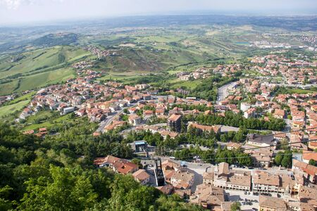 view of romagna coast from the top of monte Titano and the start of car cables in the Republic of San Marino, Italy