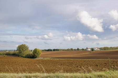 plowed land in a country autumnal landscape on the hills Stock Photo