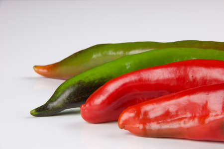 part of multicolored peppers isolated on white background