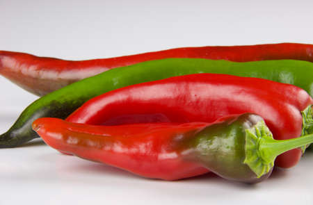 close up of colored peppers isolated on white background