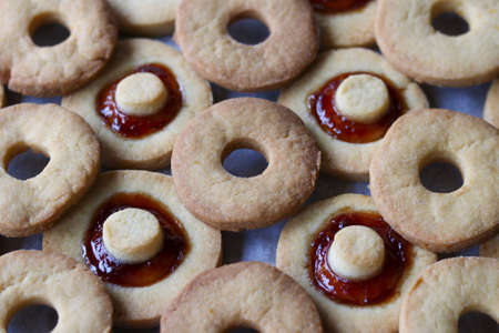 close up of shortbread biscuits some of them with jam, full frame