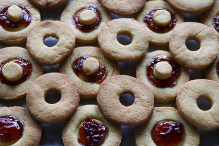 group of homemade pastry biscuits with plum jam, full frame Stock Photo