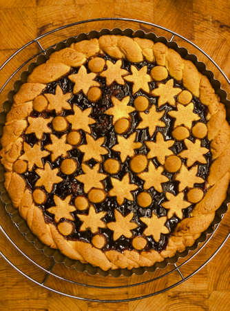 jam tart decorated with small stars of pastry, view from above