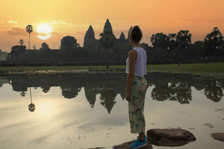 woman looking landscape of Angkor Wat at sunset, Cambodia Stock Photo