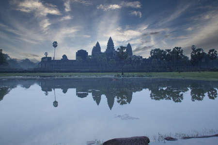Angkor Wat temple reflected in small lake in front of the entrance, Siem Reap, Cambodia