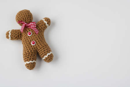 close up of gingerbread man crocheted, copy space, isolated on white