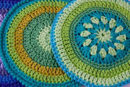 close up of crochet pattern for handmade old pot holders, full frame