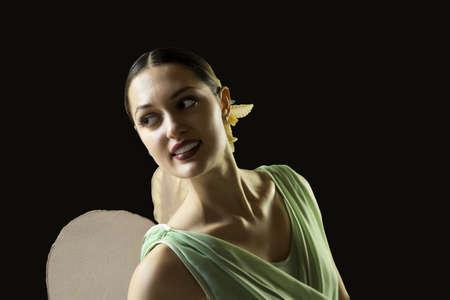 ballerina portrait smiling in stage costume, black background