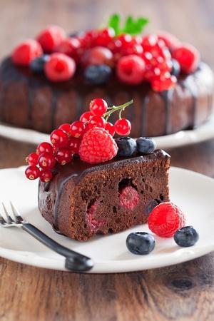 Chocolate cake slice with fresh berries, selective focus  Stock Photo
