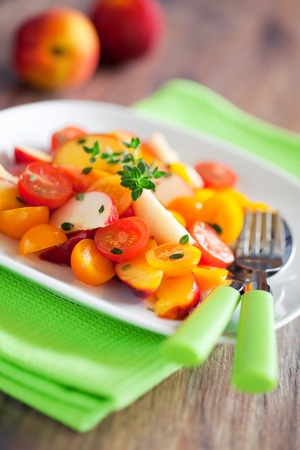 Peaches, nectarines, tomatoes and thyme salad, selective focus