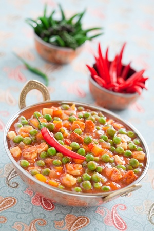 Green peas and paneer cheese in a spicy tomato sauce, selective focus  photo