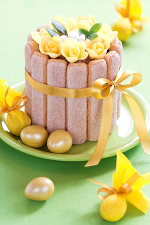 Easter chocolate cake decorated with flowers and quail eggs, selective focus