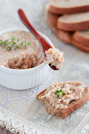 Chicken pate (rillettes) and rustic bread, selective focus