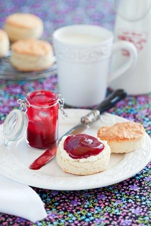 Scone with plum jam, selective focus