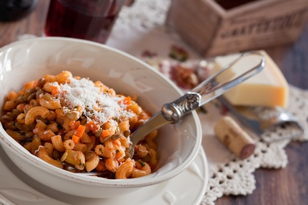 Pasta with lentils, vegetables and cheese, selective focus  Archivio Fotografico