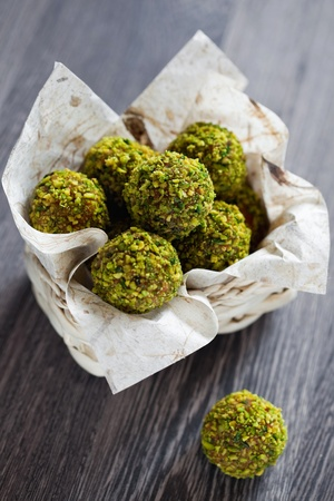 Homemade candy of dried fruits, chocolate and pistachio, selective focus