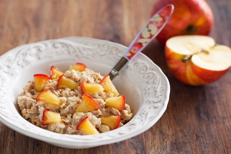 Oatmeal with caramelized apples, selective focus  photo