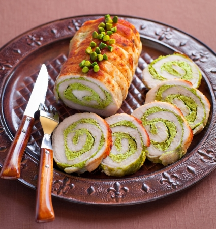 Meat roll stuffed with pistachio, selective focus photo