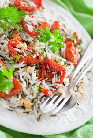 Rice salad with dried tomatoes and pine nuts, selective focus Stock Photo - 14609477
