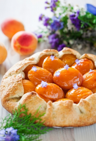 Tart with apricots and lavender, selective focus