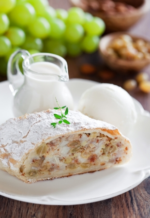 Pears strudel with almonds and raisins with vanilla sauce and ice cream. Selective focus Stock Photo - 14609436