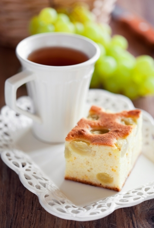 Slice of grape cake and cup of tea. Selective focus
