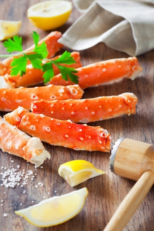 Crab legs on wooden table, selective focus