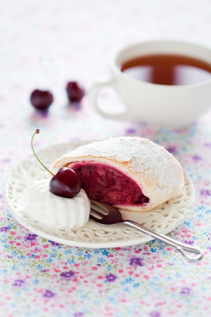 Strudel with cherries and almonds, selective focus  photo