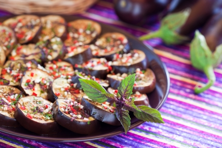 Grilled aubergine salad with garlic, chilli, basil and parsley dressing. Selective focus. Stock Photo - 14711347