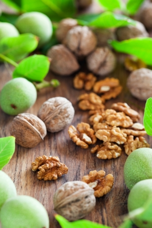 Fresh walnuts on wooden table, selective focus Stock Photo