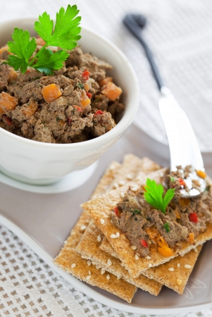 Chicken liver pate with pumpkin and crispbread, selective focus Stock Photo